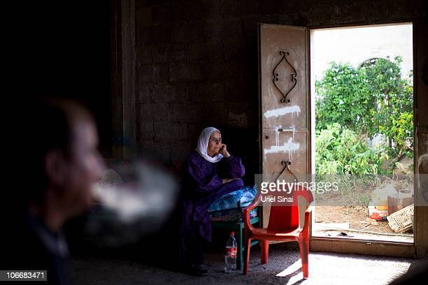 A local woman sits in her house November 10 2010 in the village of Ghajar on IsraeliLebanese border Israel's Prime Minister Benjamin Netanyahu...