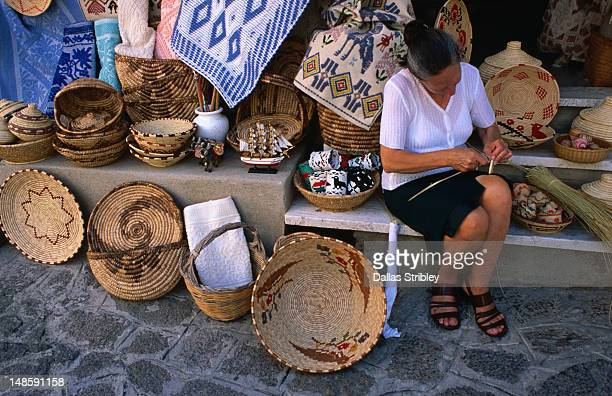 Local woman weaving baskets in the Medieval hilltop village of Castelsardo.