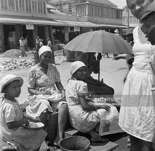 Local women gather by the market in Georgetown British Guyana