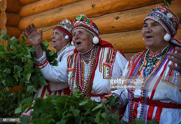 Local women in traditional Mordovskoe dress dance and sing during a media tour of Russia 2018 FIFA World Cup venues on July 17, 2015 in Saransk,...