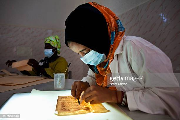 Local women restore ancient manuscripts at the Mama Haidara Centre Juma Almajid Pour La Conservation et la Restauration des Manuscripts A Tombouctou...