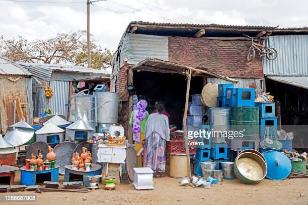 Local women shopping at little hardware store in the town Axum / Aksum, Maekelay Zone, Tigray Region, Ethiopia, Africa.