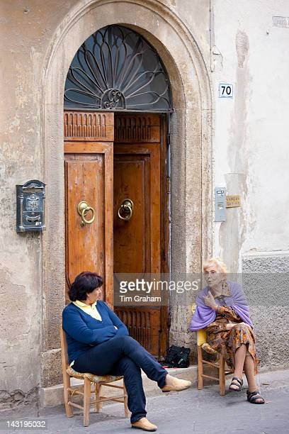 Local women sitting out in Piazza Cavovr in Montalcino Val D'OrciaTuscany Italy