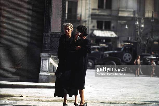 Local women stand in the street 5 days after winning the campaign 'Operation Husky' in Palermo Sicily Italy