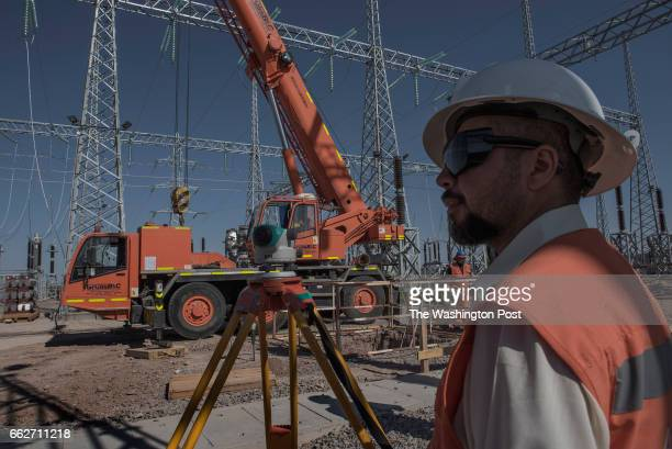 CALAMA CHILE MARCH 9 A local worker checks the installation of the disconnecting substation of the Cerro Dominador solar plant Calama Chile on March...