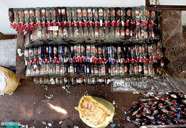 A local worker selects Kingfisher beer bottles of a restaurant at December 24 2011 in Kozhikode Kerala India