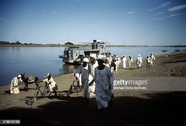 Local workers depart a ferry in Khartoum AngloEgyptian Sudan
