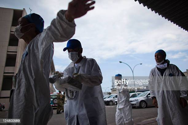 Local workers who worked around the 20km exclusion zone around the Fukushima Dai-Ichi Nuclear Power Plant, undergo a screening test for possible...