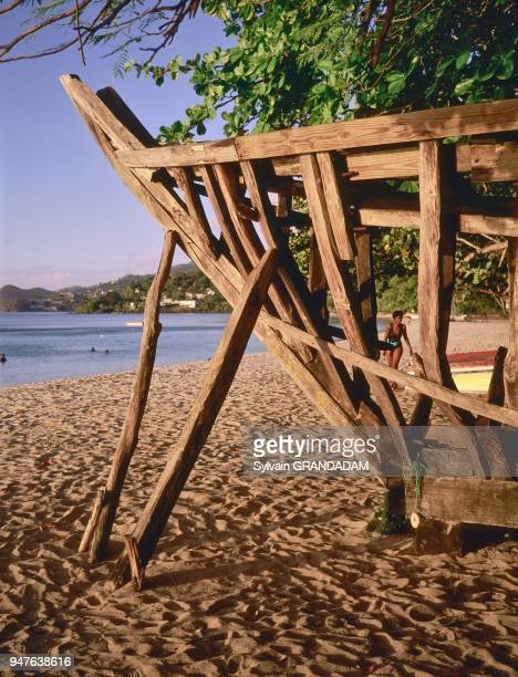 Local working boat being built on the beach Carriacou Grenada island Caribbean British West Indies