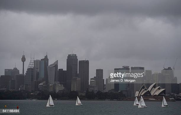Local yachtsmen don't let the heavy rain stop them enjoying harbour sailing on June 19 2016 in Sydney Australia Flood warnings have been issued for...