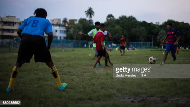 Local young children play football in a park ahead of the FIFA U17 World Cup India 2017 tournament on October 13 2017 in Kolkata India