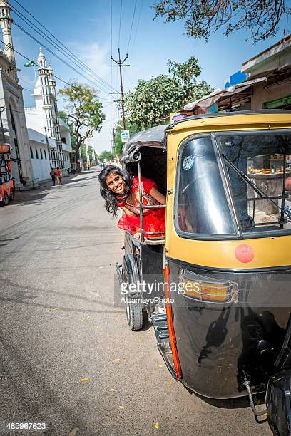local young indian woman riding in auto-rickshaw, udaipur - auto rickshaw stock pictures, royalty-free photos & images