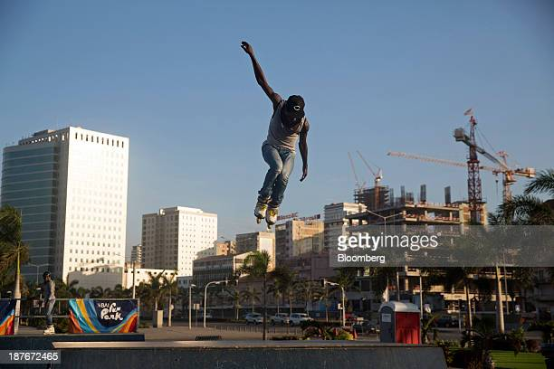 A local youth jumps high in the air while rollerblading on the promenade in Luanda Angola on Friday Nov 8 2013 Angola the largest crude oil producer...