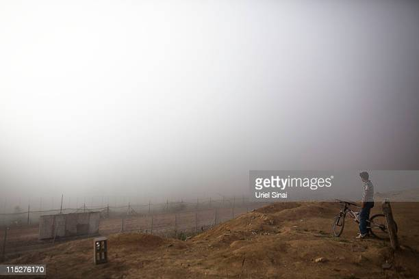 A local youth looks at Israel's border with Syria a day after ProPalestinian demonstrators stormed a ceasefire line on June 6 2011 in Israel...