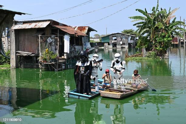 Local youth representatives dressed Stormtroopers and Darth Vader from the Star Wars film franchise patrol in a wooden boat around a submerged...