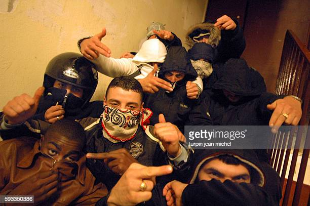 Local youths pose in a hallway in a housing project in Aubervilliers as rioting and civil disorder continues unabated for the 11th consecutive night...