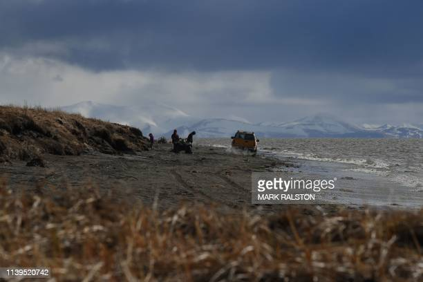 Local Yupik hunters travel beside the Bering Sea and near the climate change affected Yupik Eskimo village of Quinhagak on the Yukon Delta in Alaska...