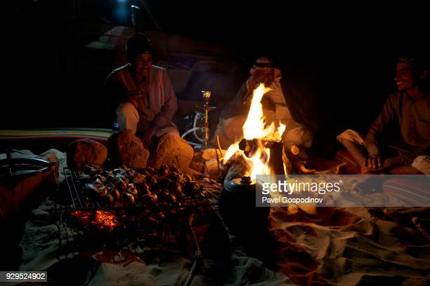 Local Zalabia Bedouins preparing barbecue in the evening in Wadi Rum (The Valley of the Moon), a protected desert wilderness in Jordan