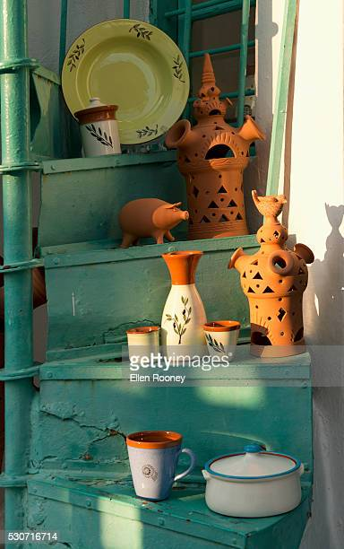 Locally made pottery displayed on a spiral staircase outside a shop; Apollonia, Sifnos, Cyclades, Greek Islands, Greece