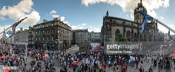 Locals and foreigners all gather along Edinburgh's Royal Mile to witness the various acts and performances during the Edinburgh Fringe Festival.