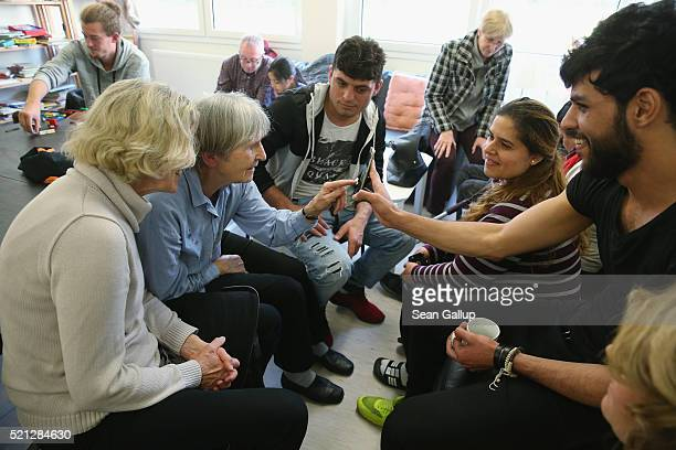 Locals and residents chat over coffee and cakes at the biweekly 'Integration Cafe' gettogether at a shelter for refugees and migrants in Zehlendorf...
