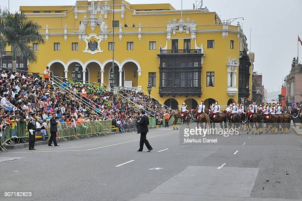 CONTENT] Locals and tourists are observing the Húsares de Junín horse mounted cavalry presidential guard from grand stand tribunes at the...