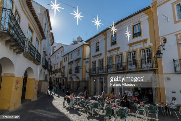 Locals and tourists enjoy a morning coffee near the taste hall of the Route of Alentejo Wines on the second day of a tour of the wineries chosen by...