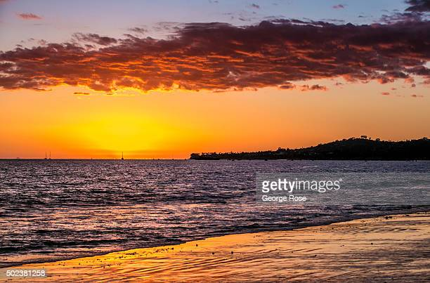 Locals and tourists share in a spectacular sunset at Butterfly Beach near downtown on November 26 in Santa Barbara California Because of its close...