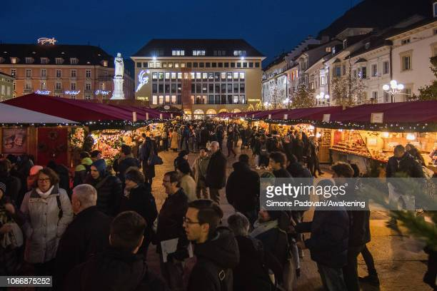 Locals and tourists visit the Christmas market on November 30 2018 in Bolzano Italy