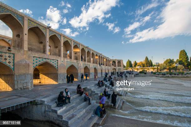 locals are relaxing in front of khaju bridge, isfahan, iran - isfahan stock pictures, royalty-free photos & images