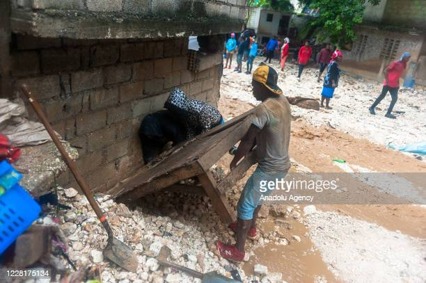 Locals are trying to recover from the effects of Storm Laura, in Port-Au-Prince, Haiti on August 23, 2020.