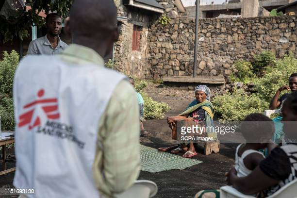 Locals attend a community meeting aimed at educating them about the symptoms and treatment of Ebola in Goma DR Congo is currently experiencing the...