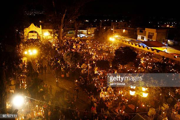 Locals attend the Dia de los Muertos celebrations at the cemetery on November 2 2009 in Mixquic Mexico