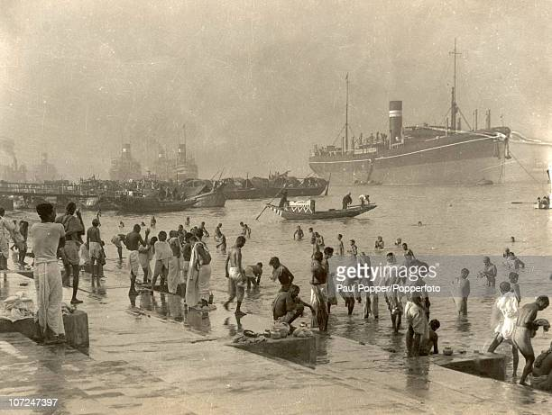 Locals bathing at the Chandpal Ghat on the Hooghly River in Calcutta circa 1920