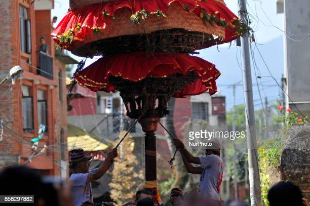 Locals carry as well as rotates top part of a chariot of Lord Narayan across the streets of Hadigaun during Lord Narayan jatra festival in Hadigaun...