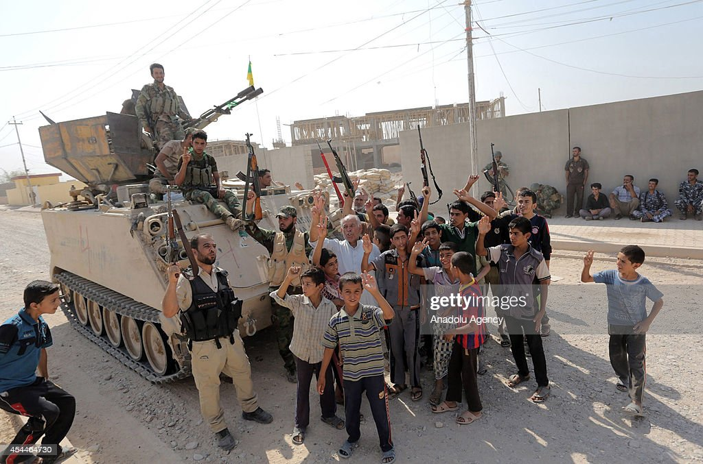 Locals celebrate after Iraqi forces have freed the northern town of Amirli which had been under the siege of Islamic State militants for over two months in Saladin ,Iraq on September 1, 2014. Supported by Kurdish forces and Shiite militias, the Iraqi army launched an offensive shortly after the U.S. carried out airstrikes against Islamic State (IS) positions near the town, and dropped aid for the nearly 20,000 Shiite Turkmen trapped in Amirli. The government forces and Kurdish peshmerga forces have been fighting against the militant group to block their advance.