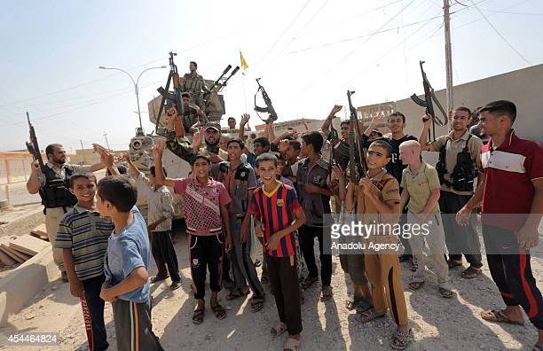Locals celebrate after Iraqi forces have freed the northern town of Amirli which had been under the siege of Islamic State militants for over two...