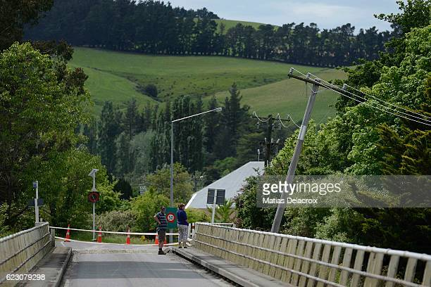 Locals check a bridge over the Waiau River in Rotherham Road 110 kms north of Christchurch as damage and land slip cause infrastructure disruption in...