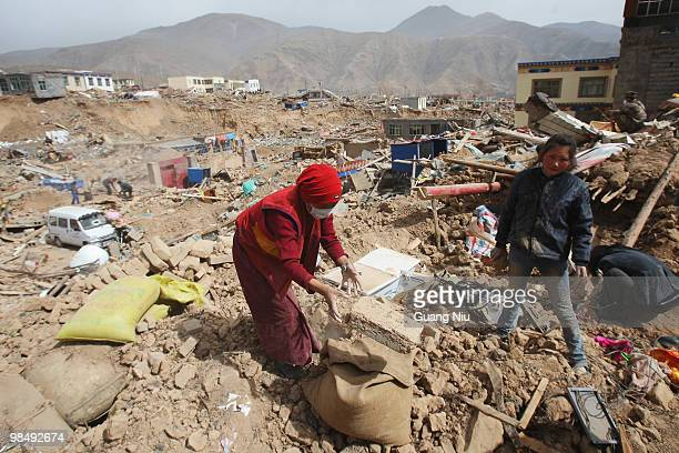 Locals clear rubble from collapsed houses following a strong earthquake on April 16 near Golmud, China. It is currently reported that 791 people have...
