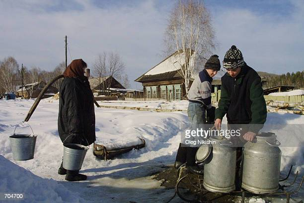 Locals collect potable water February 27 2002 in the village of Cheremshanka some 500 kilometers from Krasnoyarsk in Russias east Siberia