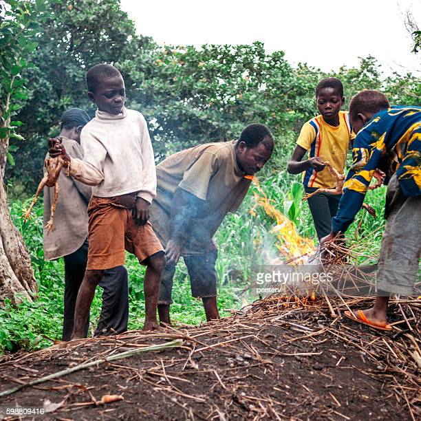 Locals cooking chicken. Benin, West Africa.