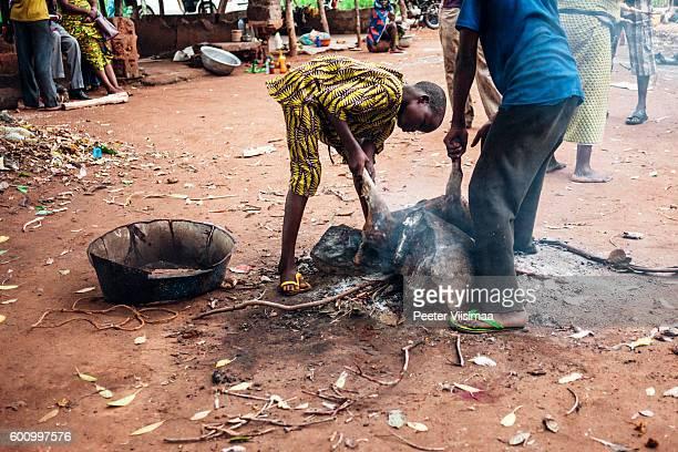 Locals cooking food. Benin, West Africa.