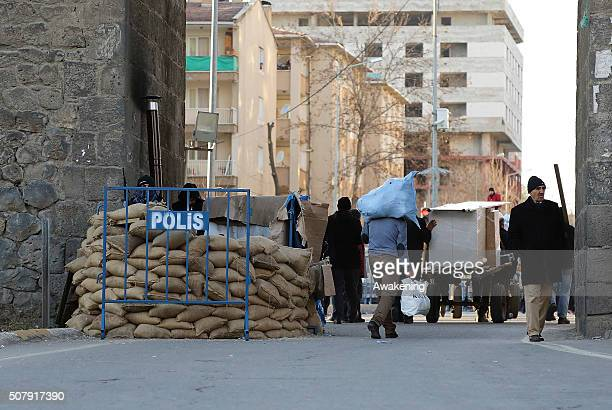 Locals cross one of the many checkpoints during a short break in the curfew on February 1 2016 in Diyarbakir Turkey Parts of Diyarbakir that is...