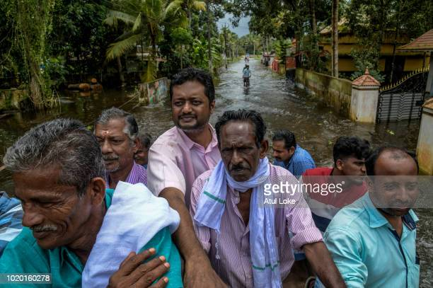 Locals from nearby villages in the Chengannur area take shelter at the relief camp in local College in Chengannur on August 20 2018 in Kerala India...