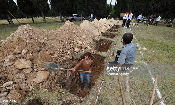 Locals dig graves for the victims of the coal mine fire at a local cemetery in Soma district of Manisa, Turkey on May 14, 2014. An explosion and fire...