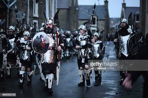 Locals dressed as Vikings march through the streets of Lerwick on January 28 in the Shetland Islands Scotland The traditional festival of fire is...
