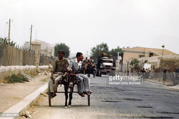 Locals drive carts in the street 5 days after winning the campaign 'Operation Husky' in Palermo Sicily Italy