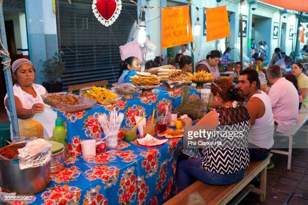 Locals eat at a street food market Oaxaca is known throughout Mexico and internationally for its great food Seen as a centre for Mexican cuisine...