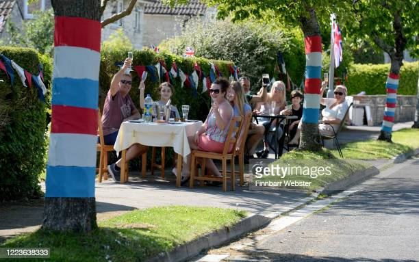 Locals enjoy a street party on May 08, 2020 in Dorchester, United Kingdom. The UK commemorates the 75th Anniversary of Victory in Europe Day with a...