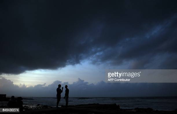 Locals enjoy sunset after the passage of Hurricane Irma in Cojimar neighborhood in Havana on September 10 2017 Residents of Cuba's historic capital...